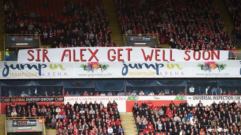 Aberdeen fans display a banner in support of former manager Sir Alex Ferguson