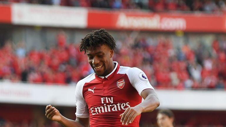 Alex Iwobi celebrates after extending Arsenal's lead