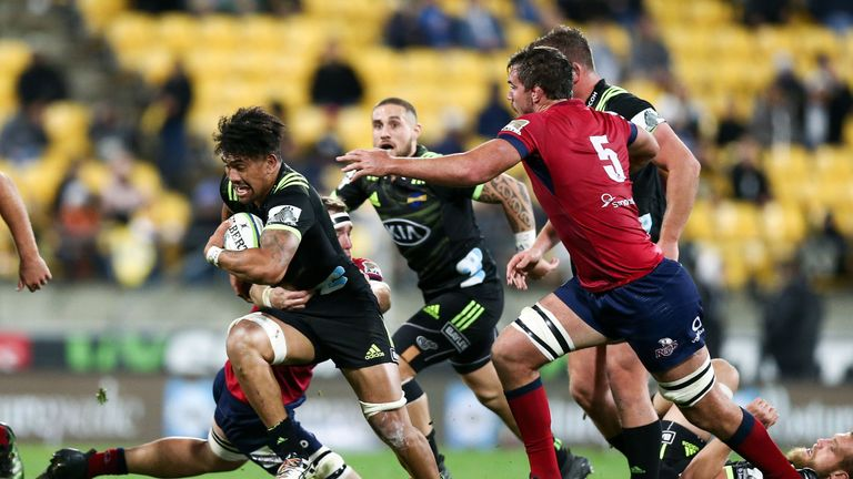 Ardie Savea breaks for the Hurricanes against the Reds