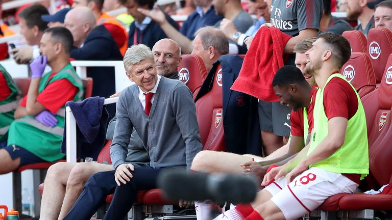 Arsene Wenger shares a joke with his players