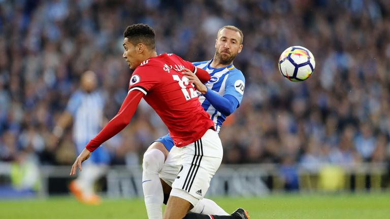 Chris Smalling and Glenn Murray during the Premier League match between Brighton and Hove Albion and Manchester United at Amex Stadium on May 4, 2018 in Brighton, England.