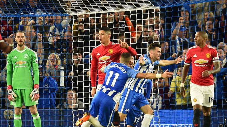 Pascal Gross celebrates the opening goal for Brighton against Manchester United, Premier League