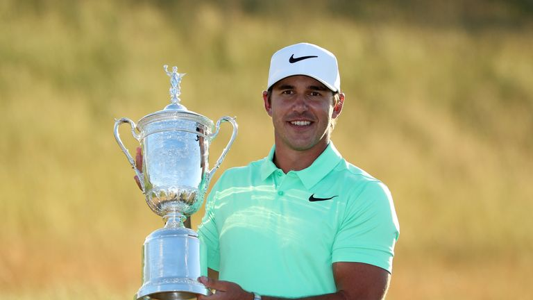 Koepka displays the US Open trophy after his victory last year