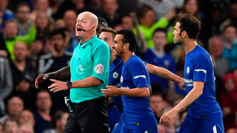 Chelsea players surround referee Lee Mason