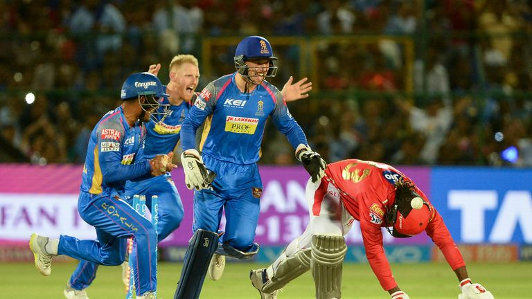 Jos Buttler and Ben Stokes of celebrate the wicket of Kings XI's Chris Gayle (Credit: AFP)