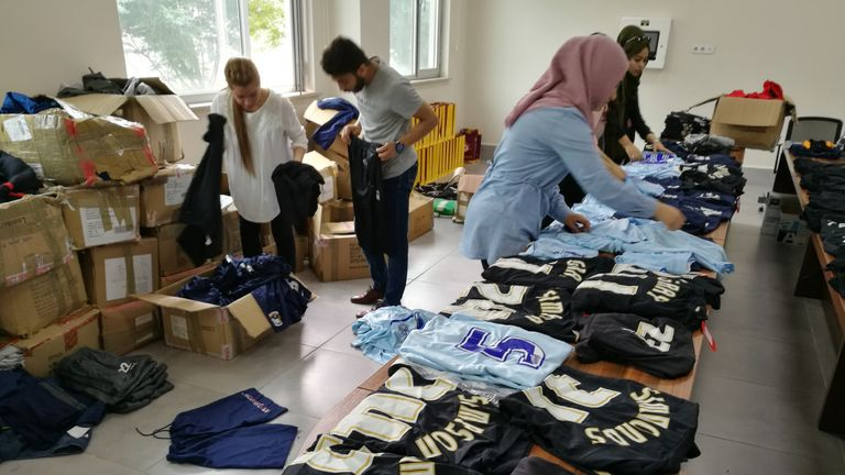 Volunteers at Ishik University in Northern Iraq prepare to distribute the kit