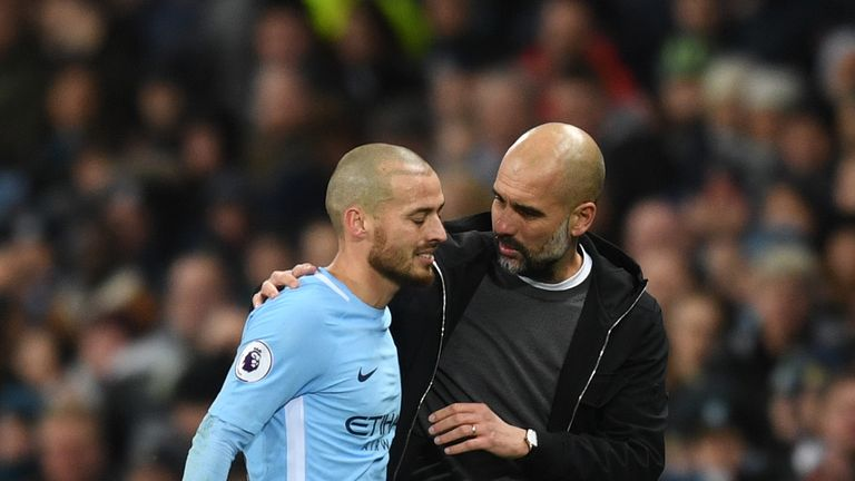 David Silva and Pep Guardiola during the Premier League match between Manchester City and West Bromwich Albion at Etihad Stadium on January 31, 2018 in Manchester, England.
