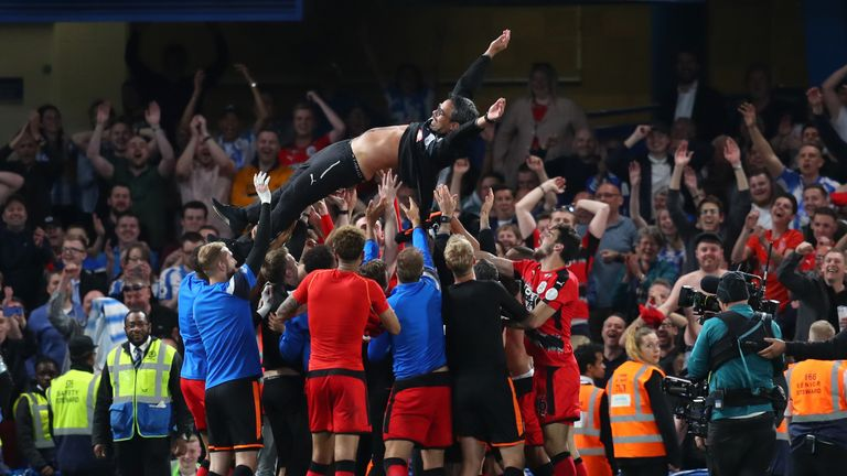 Huddersfield players celebrate their Premier League survival at Stamford Bridge