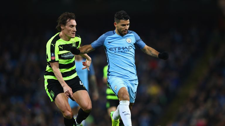 Dean Whitehead and Sergio Aguero in action during Huddersfield's FA Cup replay with Manchester City in 2017