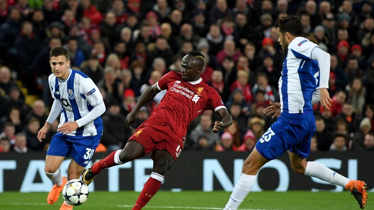 Sadio Mane shoots under pressure from Diogo Dalot (L) and Diego Reyes during the UEFA Champions League Round of 16, Second Leg match between Liverpool and FC Porto at Anfield on March 6, 2018