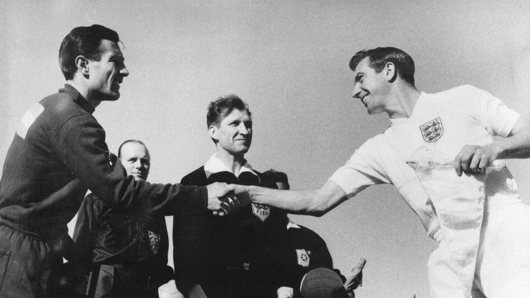 England captain Johnny Haynes shakes hands with Argentina counterpart Ruben Navarro in Rancagua