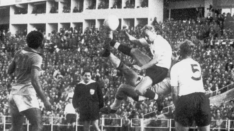 Brazil's Mazzola and England back Don Howe collide in the air during the match in Gothenburg
