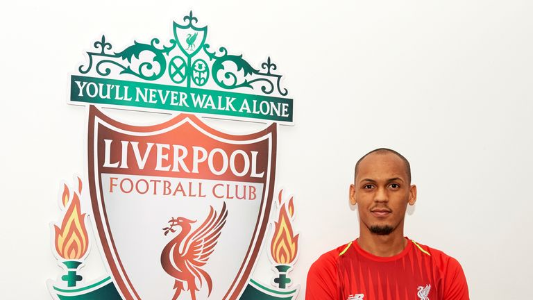 Fabinho poses for photographs at Melwood Training Ground after signing for Liverpool