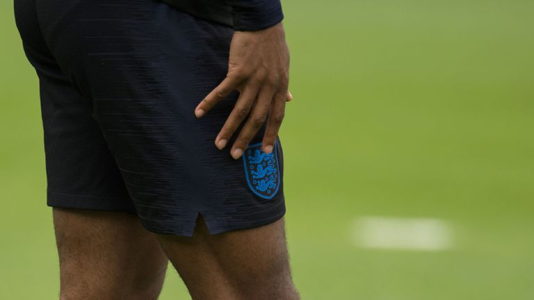 Sterling was pictured with a tattoo of an M16 assault rifle on his leg