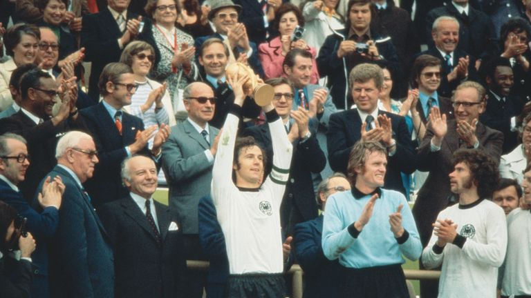 West Germany's Franz Beckenbauer (centre) became the first captain to lift the new FIFA trophy after leading his side to victory over Holland in the World Cup Final at the Olympic Stadium in Munich