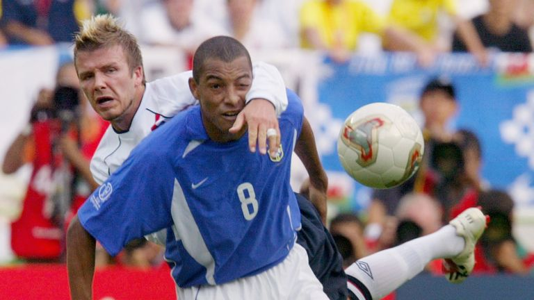 Gilberto tangles with David Beckham during Brazil's quarter-final victory over England in 2002