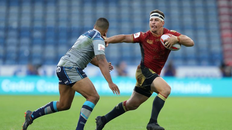 Greg Bird attacking for Catalans Dragons in the Challenge Cup quarter-final