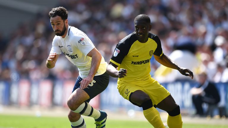 Greg Cunningham is put under pressure by Marvin Sordell during the Sky Bet Championship match between Preston North End and Burton Albion at Deepdale on May 6, 2018