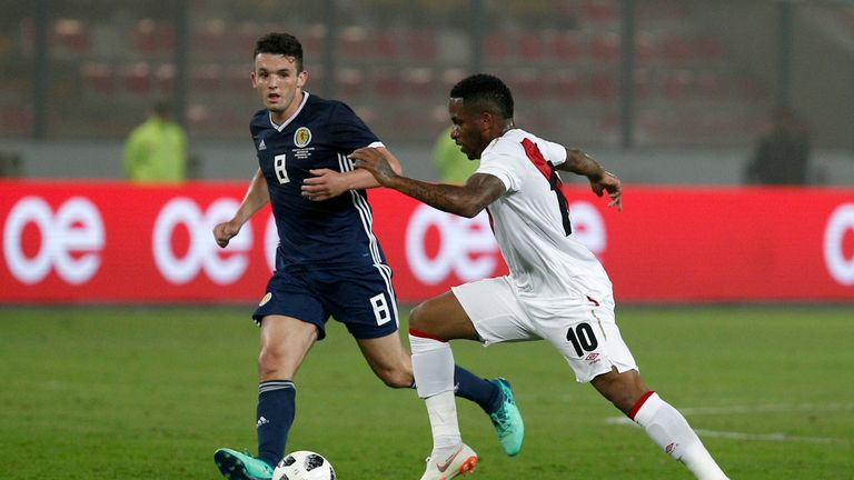 Jefferson Farfan of Peru fights for the ball against John McGinn of Scotland during the international friendly match