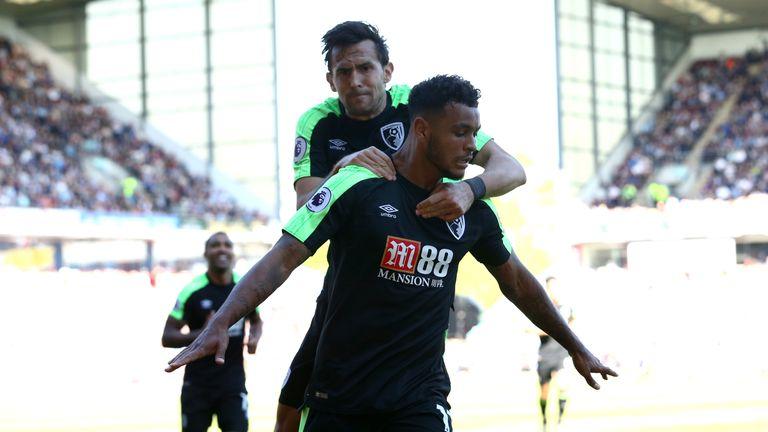 Joshua King celebrates his goal with teammate Charlie Daniels