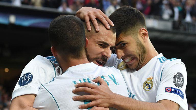 Karim Benzema (C) celebrates scoring with Lucas Vazquez (L) and Raphael Varane during the UEFA Champions League semi-final second-leg football match Real Madrid CF vs FC Bayern Munich