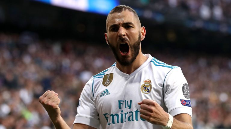 Karim Benzema of Real Madrid celebrates as he scores his side's first goal during the UEFA Champions League Semi Final Second Leg match v Bayern Munich at the Bernabeu on May 1, 2018 in Madrid, Spain