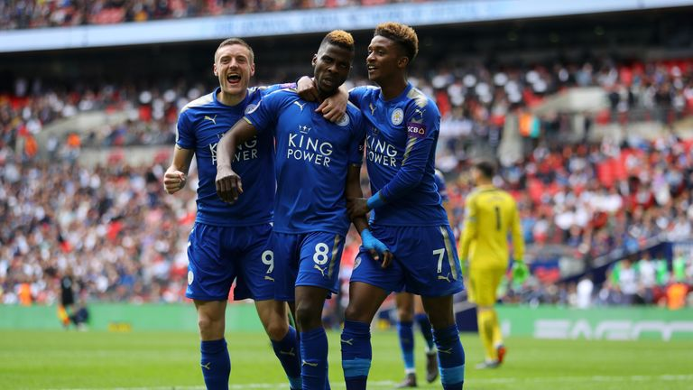 Kelechi Iheanacho celebrates with Jamie Vardy and Demarai Gray after scoring Leicester's third