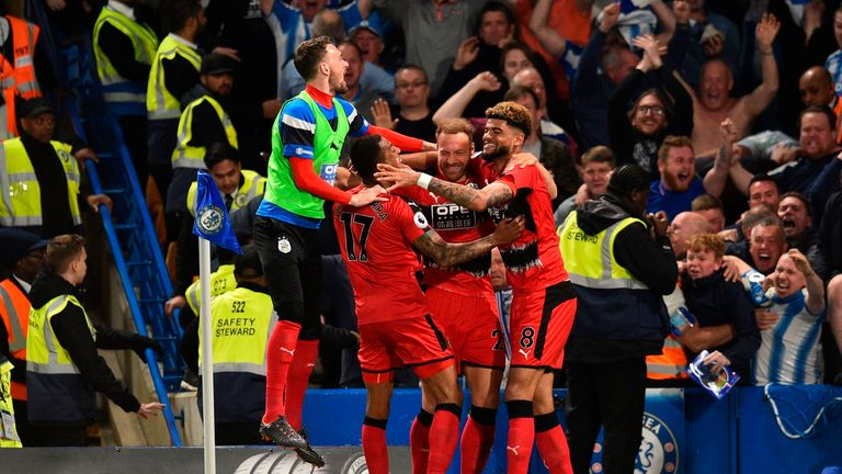Laurent Depoitre (C) celebrates with teammates after giving Huddersfield the lead at Stamford Bridge