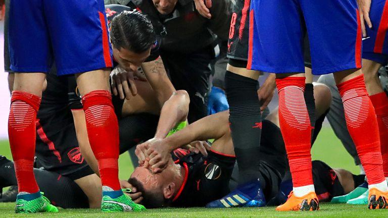Arsenal's Laurent Koscielny receives medical attention at the Wanda Metropolitano