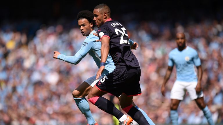 Leroy Sane and Mathias Jorgensen in action during the at the Etihad Stadium on May 6, 2018