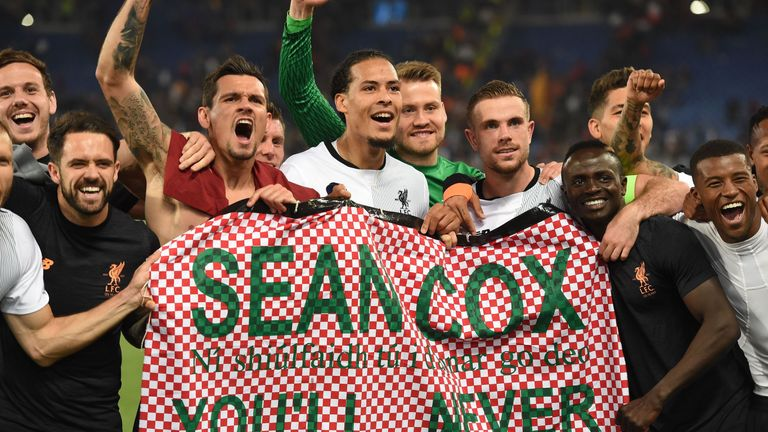 Liverpool players celebrated with a Sean Cox banner after their Champions League semi-final victory over Roma