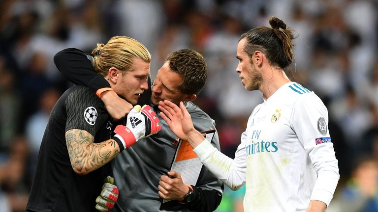 Players and staff from both sides sought to console Karius at the final whistle