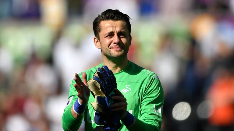 Lukasz Fabianski appears visibly upset as Swansea City are relegated from the Premier League