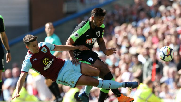 Burnley's Matthew Lowton tackles Bournemouth's Lys Mousset