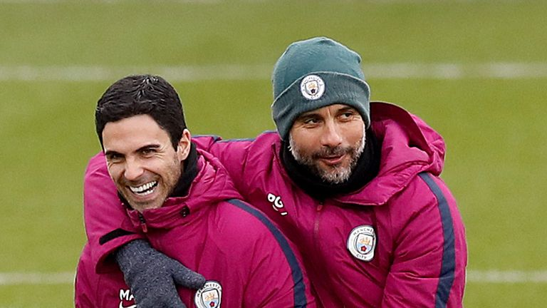 Manchester City manager Pep Guardiola with assistant coach Mikel Arteta during a training session at the City Football Academy on March 6, 2018