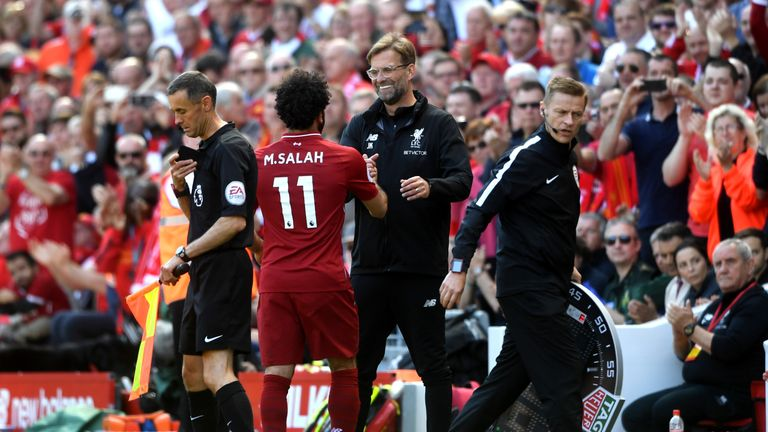 Jurgen Klopp shakes hands with Mohamed Salah as he comes off for Ben Woodburn (not pictured)