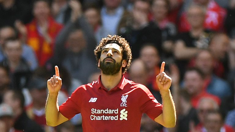 Mohamed Salah celebrates scoring against Brighton