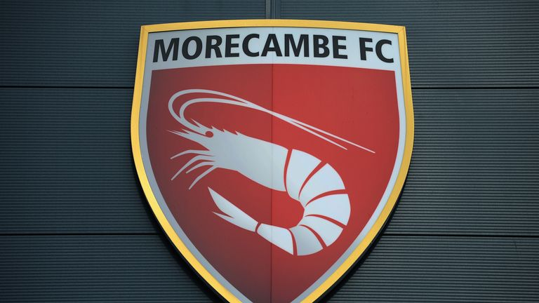 MORECAMBE, ENGLAND - OCTOBER 19: xxxx of Morecambe tackles xxxx of AFC Wimbledon during the Sky Bet League Two match between Morecambe and AFC Wimbledon at Globe Arena on October 19, 2013 in Morecambe, England, (Photo by Tony Marshall/Getty Images)