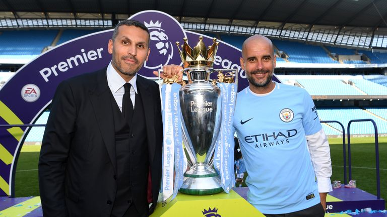 Khaldoon Al Mubarak and Pep Guardiola pose with the Premier League trophy
