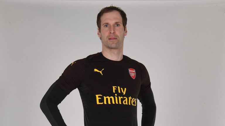 Petr Cech models the goalkeeper's kit, which is black and brown