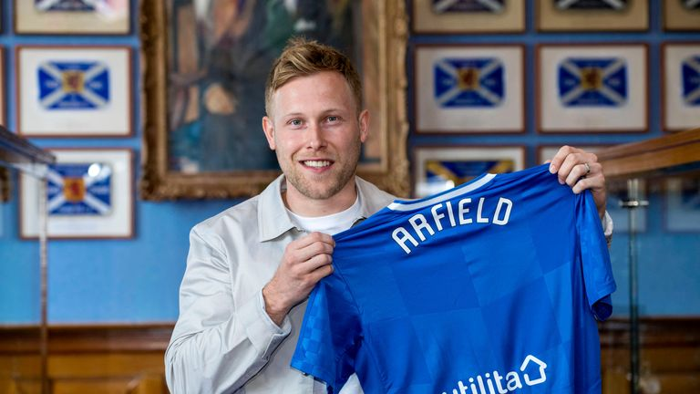 New Rangers signing Scott Arfield poses with the shirt