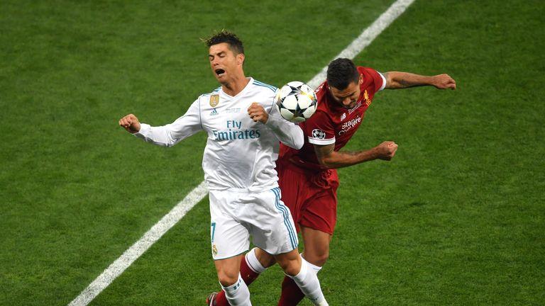 Dejan Lovren battles with Cristiano Ronaldo