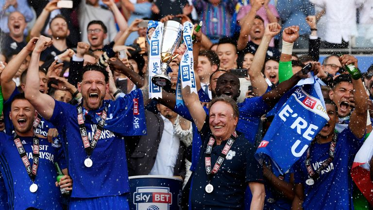 Cardiff City's Sean Morrison celebrates gaining promotion to the Premier League with Warnock