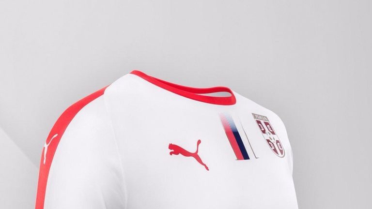 Serbia's away shirt is white with a red crew-neck, with a red stripe running down the sleeve