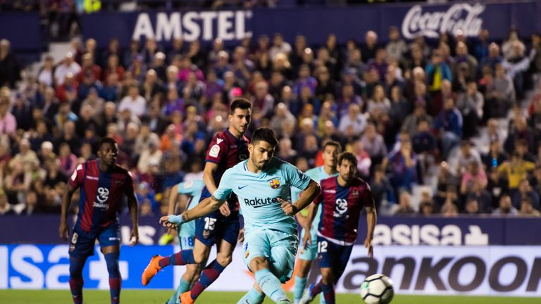 Luis Suarez strokes in his penalty to give Barcelona hope of a comeback