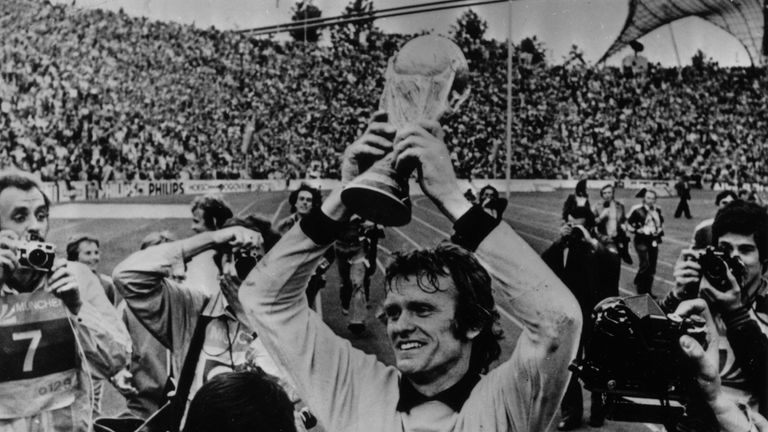 German goalkeeper Sepp Maier holds the World Cup trophy aloft, after West Germany's 2-1 victory over Holland in the 1974 World Cup Final