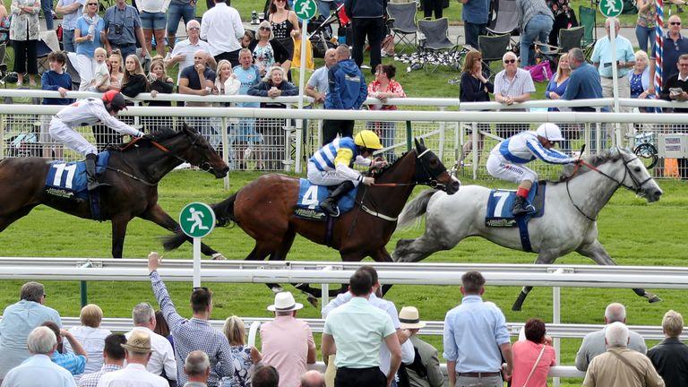 Thundering Blue (right) ridden by jockey Andrea Atzeni goes on to win the Equinity Technology Handicap at York