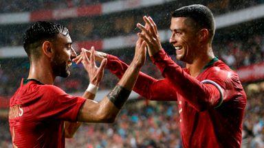 Cristiano Ronaldo (R) celebrates with Bruno Fernandes