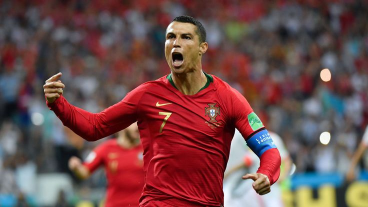 Portugal forward Cristiano Ronaldo celebrates a goal after shooting a penalty kick during the Russia 2018 World Cup Group B football match between Portugal and Spain at the Fisht Stadium in Sochi on June 15, 2018.