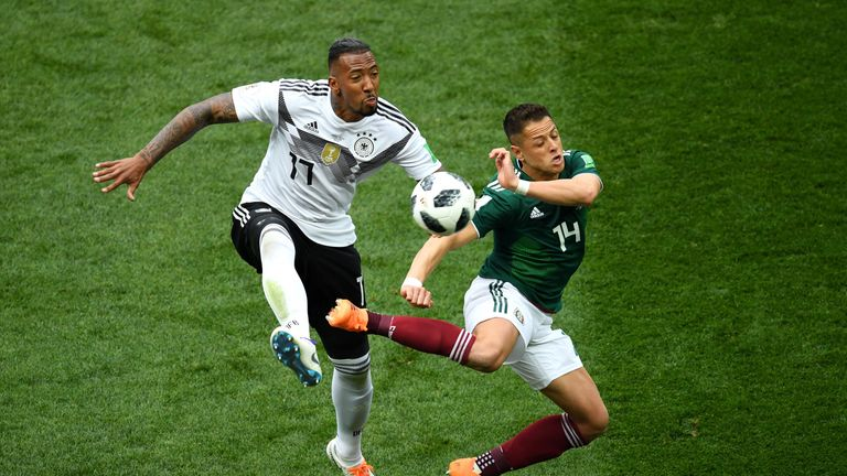 Javier Hernandez is challenged by Jerome Boateng